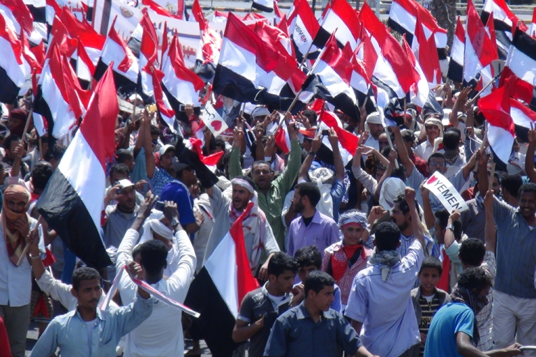 <p>Yemeni protesters call for southern independence during a demonstration on the first anniversary of the ouster of autocratic leader Ali Abdullah Saleh in Aden on February 21, 2013. An army tank shelled a funeral tent in the southern Yemeni province of Dali on Dec. 27, 2013, killing 13 people, including children and a medic.</p>