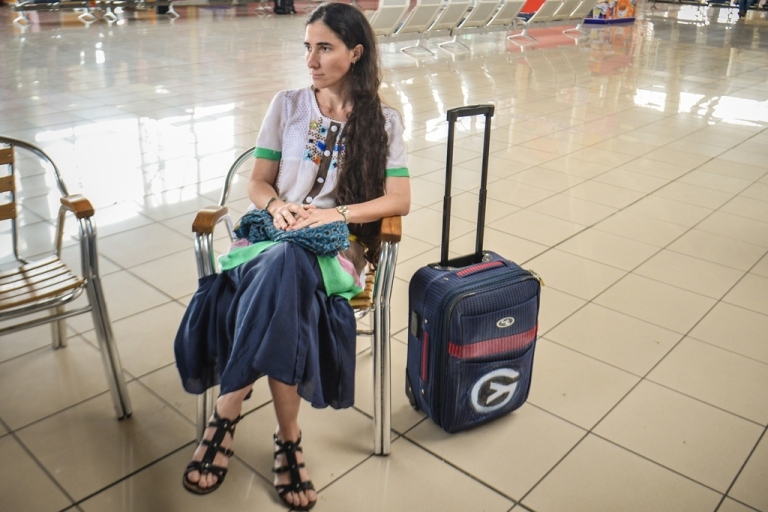 <p>Cuban blogger Yoani Sanchez waits for the check-in to open upon departing from Havana's airport for Brazil on Feb. 17.</p>