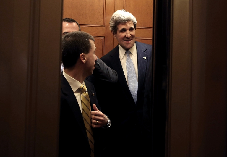 <p>Sen. John Kerry (D-MA) is surrounded by security officers as he leaves from the Senate floor in a elevator after the full Senate voted on him to become Secretary of State, on January 29, 2013 on Capitol Hill in Washington DC.</p>
