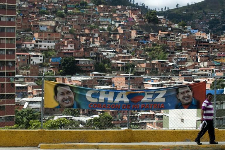 <p>Even in his long absence for cancer treatment in Cuba, Venezuelan President Hugo Chavez seems omnipresent, especially in slums like Caracas' 23 de Enero.</p>