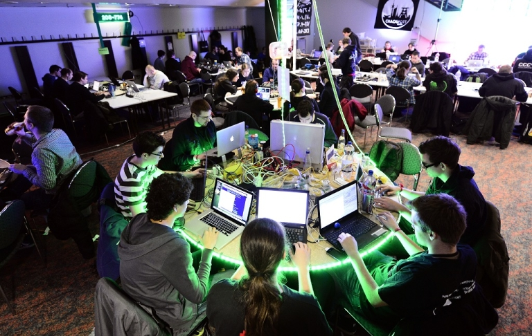 <p>Participants work at their laptops at the annual Chaos Computer Club (CCC) computer hackers' congress, called 29C3, on December 28, 2012 in Hamburg, Germany. The 29th Chaos Communication Congress (29C3) attracts hundreds of participants worldwide annually to engage in workshops and lectures discussing the role of technology in society and its future.</p>
