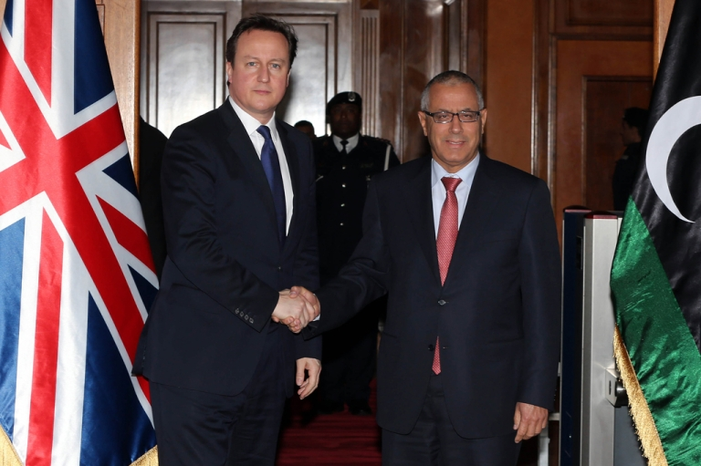 <p>Libyan prime minister Ali Zaidan (R) greets British Prime Minister David Cameron (L) ahead of their meeting as part of the British PM visit in Libya on January 31, 2013 in Tripoli. Cameron does a surprise visit in Libya following a one-day-visit in Algeria in the wake of this month's hostage crisis in the Sahara in which several Britons were killed.</p>