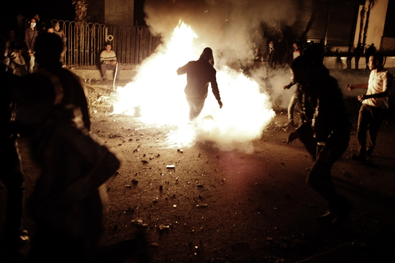 <p>An Egyptian protester kicks a live tear gas canister into a fire during clashes with riot police near Tahrir Square on Jan. 27, 2013, in Cairo, Egypt. Violent protests continued across Egypt two days after the second anniversary of the Egyptian Revolution that overthrew former President Hosni Mubarak.</p>