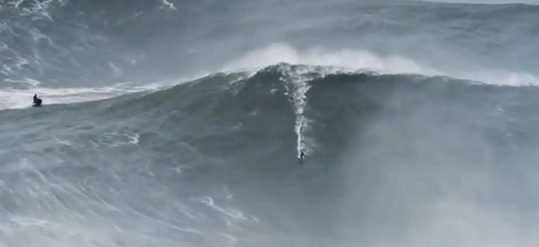 <p>Garrett McNamara breaks his own world record by surfing a 100-foot wave off the coast of Portugal on January 29, 2013.</p>