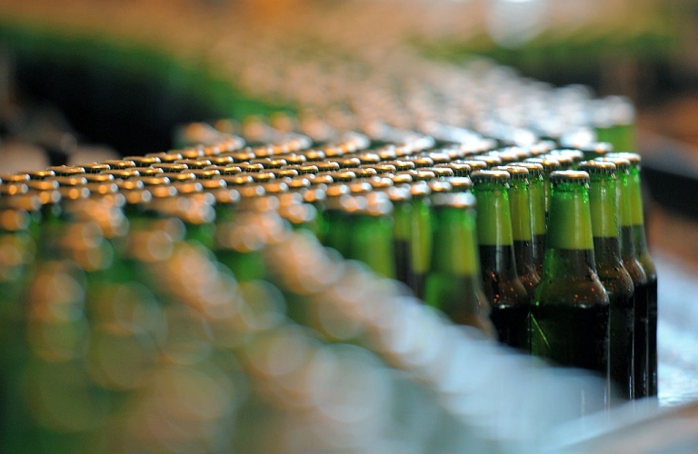 <p>A happy sight for Prince Pils, bottles of beer are seen at the production line of Dutch brewer Heineken factory.</p>