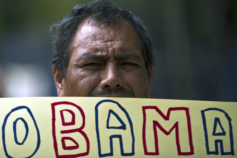 <p>A Mexican man holds a sign during a protest in front of the US embassy against the failure of the US immigration reform, on Jan. 21, 2013, in Mexico City.</p>