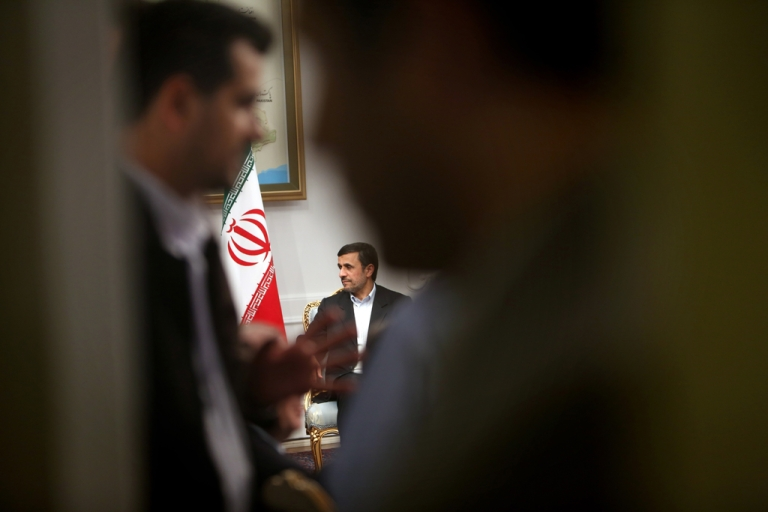 <p>Iranian President Mahmoud Ahmadinejad (C) meets with Syrian Prime Minister Wael al-Halaqi (unseen) in Tehran on January 15, 2013.</p>