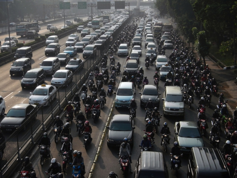 <p>Commuter vehicles queue in a gridlock during rush hour traffic in Jakarta on September 7, 2012. At least 1,000 new vehicles are added every day to the streets of Jakarta, where some eight million cars crawl through one of Asia's worst traffic jams every day, according to private and government studies.</p>