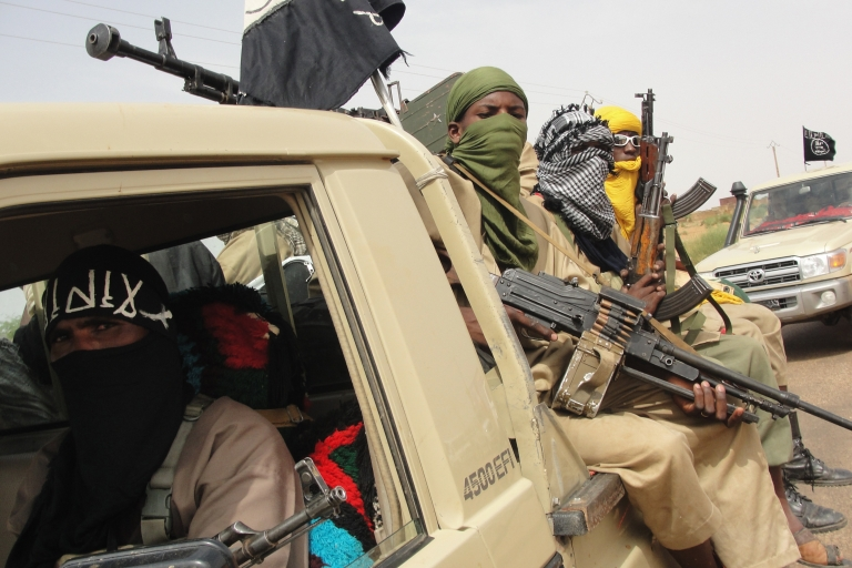 <p>Photo taken on Aug. 7, 2012, shows fighters of the Islamic group Ansar Dine standing guard at the Kidal Airport in northern Mali.</p>