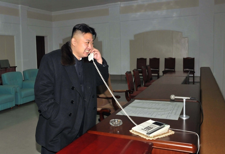 <p>This picture taken by North Korea's official Korean Central News Agency (KCNA) on December 12, 2012 shows North Korean leader Kim Jong-Un celebrating the launch of the Unha-3 rocket, carrying the satellite Kwangmyongsong-3, at the general satellite control and command center in Pyongyang. Hundreds of thousands of North Korean soldiers and civilians rallied on December 14 in the centre of Pyongyang for a mass celebration of the country's long-range rocket launch, state television showed.</p>