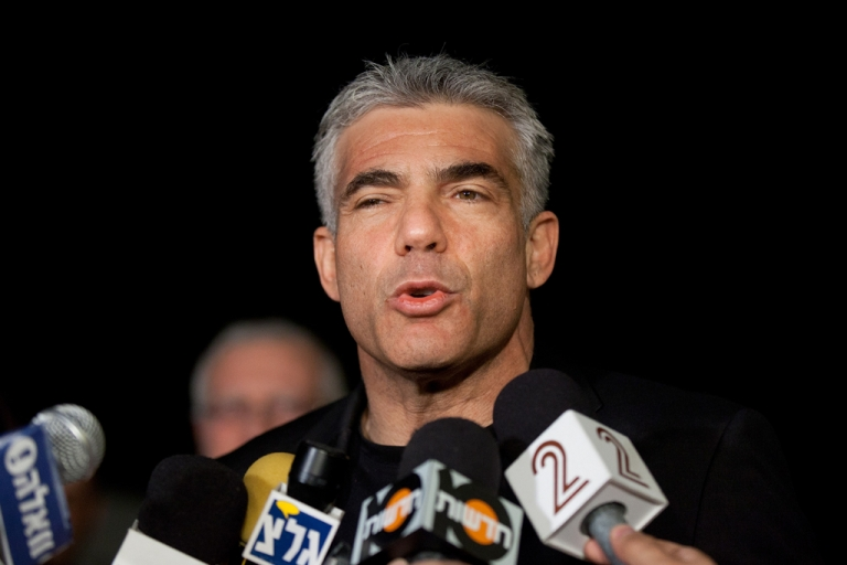 <p>Yair Lapid, leader of the Yesh Atid party, speaks to members of the press outside his house following his unexpectedly strong showing in this week's elections on Jan. 23, 2013 in Tel Aviv, Israel.</p>