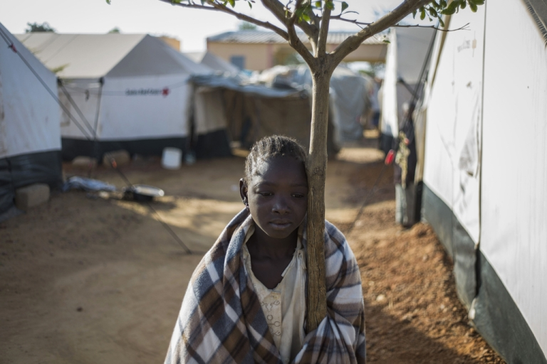 <p>A girl who fled northern Mali rests her head against a tree at a camp for internally displaced persons (IDPs) in Sevare, Mali, on Jan. 23, 2013. With the focus on the military gains, the human impact has slid from view as aid agencies warn that the combination of insecurity, food shortages and drought threatens the lives of those displaced by fighting in the region.</p>