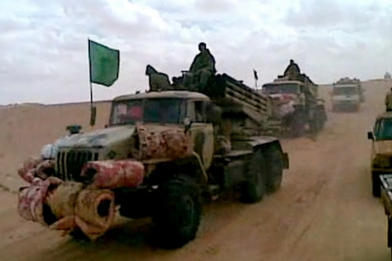 <p>A picture grabbed from a mobile phone video shows rebel fighters in the Malian desert. The Arab Spring has enabled such groups to become more mobile.</p>