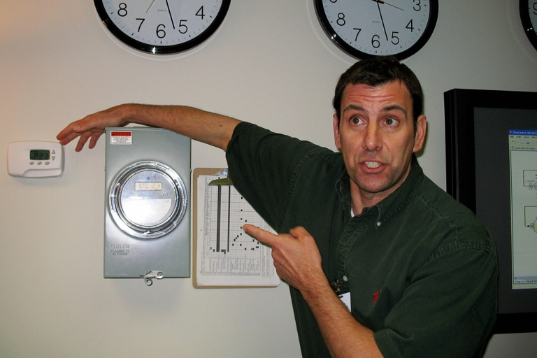 <p>IBM Information Technology Architect Jeff Mausolf points out a computerized electric meter (C) and a