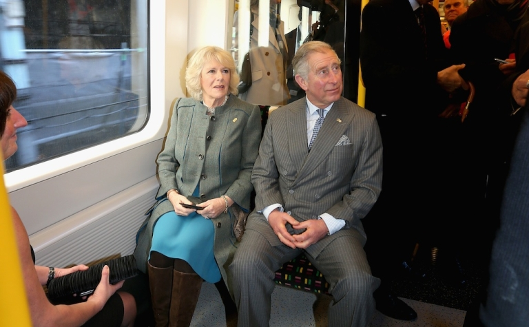 <p>Prince Charles and his wife, Camilla, enjoying a rare journey on the London Underground.</p>