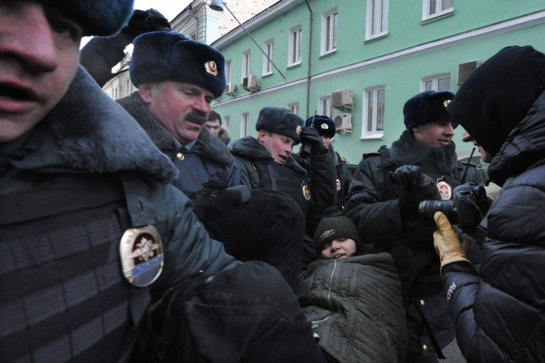 <p>Police detain a gay rights activist during a protest outside the lower house of Russia's parliament, the State Duma, in Moscow on Jan. 25, 2013.</p>