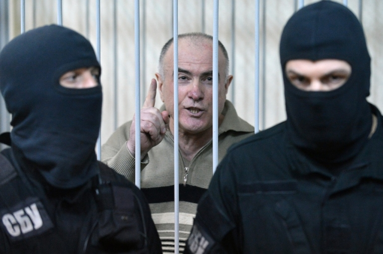 <p>Former chief of the external surveillance department of the Ukrainian Interior Ministry Olexiy Pukach says that the former president Leonid Kuchma and the former speaker Volodymyr Lytvyn must to be together with him in the cage, after the verdict reading of his trial for the murder of opposition journalist Georgy Gongadze in 2000, on January 29, 2013 at Kiev district court.</p>