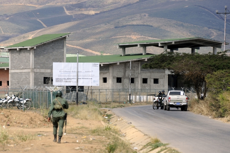 <p>Military forces outside the Uribana prison in Lara state, Venezuela, on Jan. 26, 2013.</p>