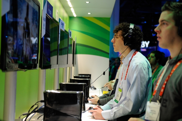 <p>Attendees play video games at Microsoft's Xbox 360 display at the 2012 International Consumer Electronics Show at the Las Vegas Convention Center on Jan. 10, 2012, in Las Vegas, Nevada. The removal of the Chinese government's ban on video games would allow major consoles to launch their products in China for the first time since 2000.</p>