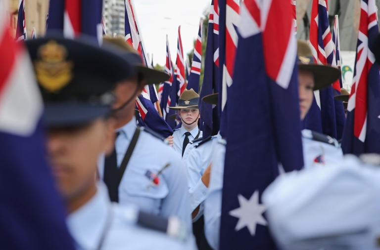<p>Members of the Australian Air Force Cadets hold Australian flags as they march during the annual Anzac Day march on April 25, 2013 in Melbourne, Australia.</p>