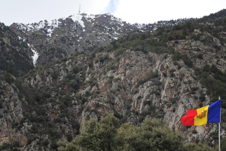 <p>A photo taken on April 2, 2013 shows the flag of the Andorra principality in Andorra La Vella.</p>