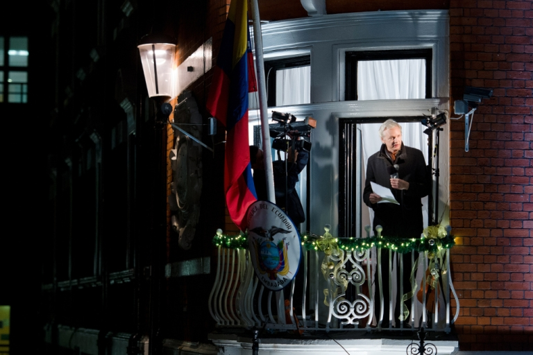<p>Wikileaks founder Julian Assange addresses members of the media and supporters from the window of the Ecuadorian embassy in Knightsbridge, west London on Dec. 20, 2012.</p>