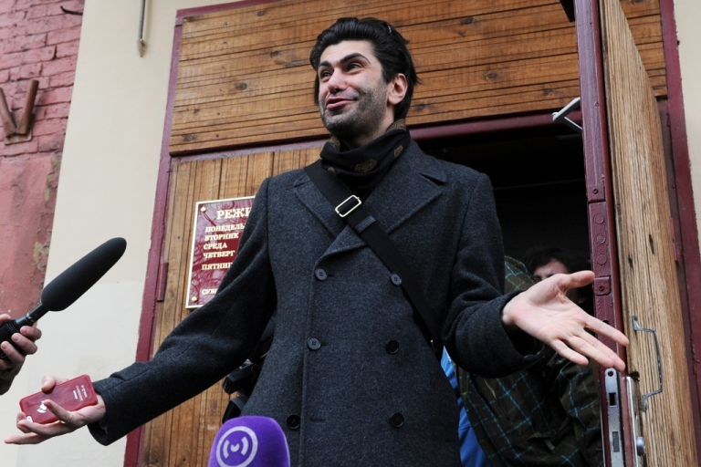 <p>A star dancer at the Bolshoi ballet Nikolai Tsiskaridze leaves a court building in Moscow on April 12, 2013. A Moscow court hears a complaint from Tsiskaridze, who alleges being unfairly treated by the company which blamed him over the acid attack on the troupe's artistic director.</p>