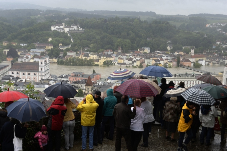 <p>Spectators look at the overflooded old city of Passau, southern Germany, on June 3, 2013 as parts of the eastern and southern Germany were flooded due to heavy and ongoing rainfalls.</p>