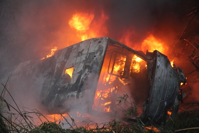 <p>A bus lies at the side of a ravine in flames following a traffic accident at Nandan county section of 210 national highway on January 10, 2012 in Hechi, China. Another city bus caught fire in the Chinese city of Xiamen on June 7, 2013, killing at least 42 and injuring 33.</p>