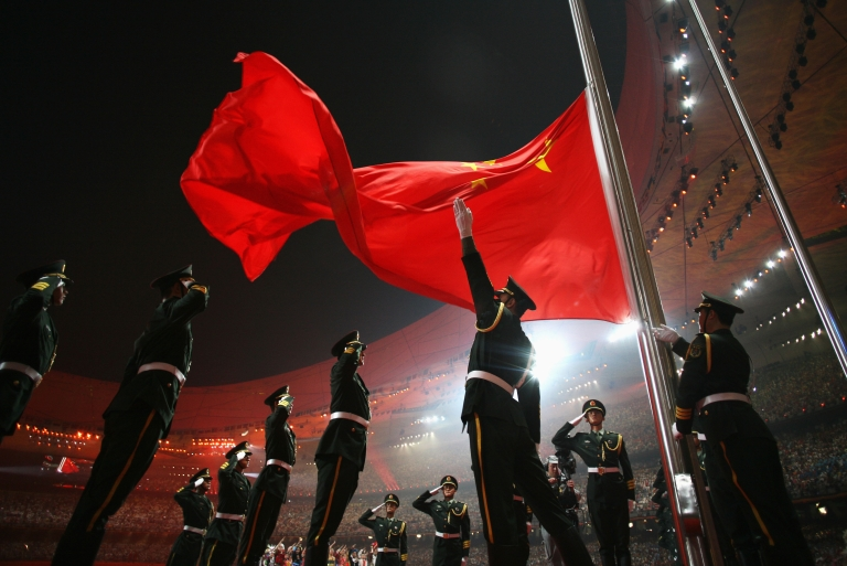 <p>The Chinese flag is raised during the Opening Ceremony for the 2008 Beijing Summer Olympics.</p>