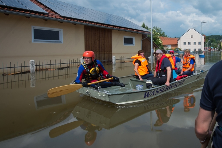<p>Rescue forces from the bavarian red cross (BRK-Wasserwacht) help residents to get private stuff from their homes out of the suburb Fischerdorf, which is flooded by the swollen Danube river on June 7, 2013, in Deggendorf, Germany.</p>
