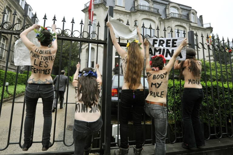 <p>Femen activists protest for the freeing of jailed Tunisian activist Amina Tyler on May 30, 2013, in front of the Tunisian Embassy in Brussels.</p>