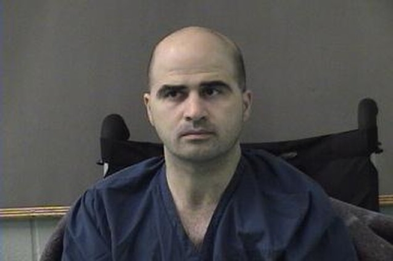<p>BELL COUNTY, TX - APRIL 9: In this photo released by the Bell County Sheriff's Office, U.S. Maj. Nidal Hasan, the Army psychiatrist who is charged with murder in the Fort Hood shootings, is seen in a booking photo after being moved to the Bell County Jail on April 9, 2010 in Belton, Texas.</p>