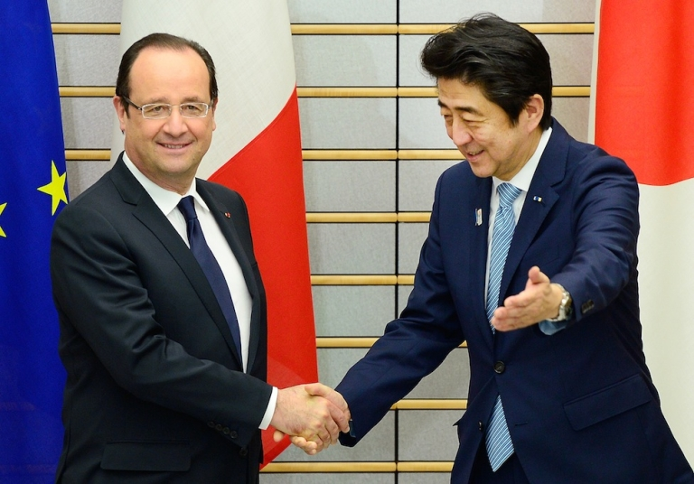 <p>French President Francois Hollande (L) is welcomed by Japanese Prime Minister Shinzo Abe (R) prior to their meeting at Abe's official residence in Tokyo on June 7, 2013. Hollande went on to call the Japanese people 'Chinese' during a speech.</p>