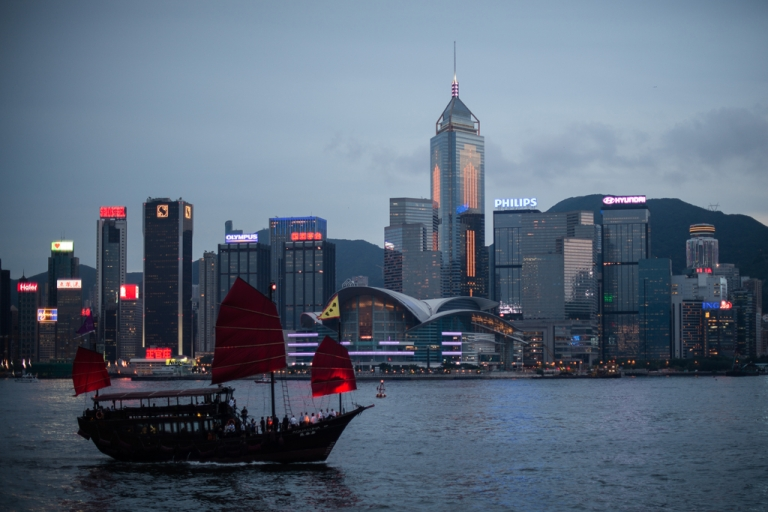 <p>A junk sails on Victoria Harbour in front of the Hong Kong skyline on June 3, 2013.</p>