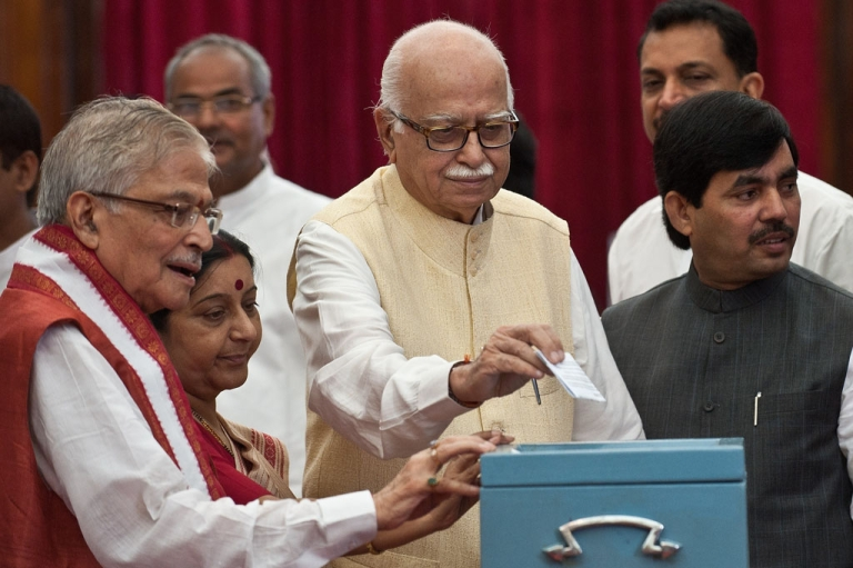 <p>Senior Bhartiya Janata Party (BJP) President L. K. Advani (C) resigned from all posts on June 10, 2013.</p>
