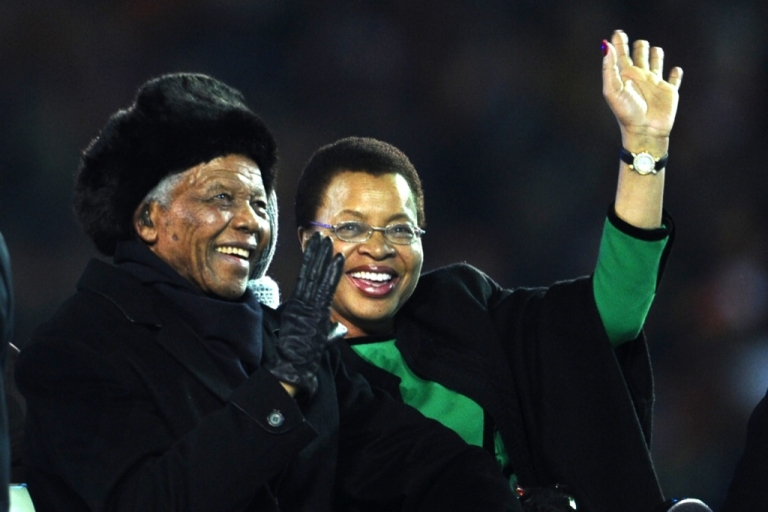 <p>South Africa's former President Nelson Mandela and his wife Graca Machel arrive during the closing ceremony prior to the 2010 World Cup football final Netherlands vs. Spain on July 11, 2010 at Soccer City stadium in Soweto, suburban Johannesburg.</p>