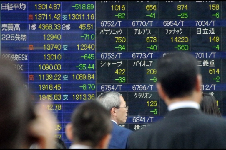<p>Pedestrians walk past a stock prices shown in the window of a securities company in Tokyo on June 5, 2013. The benchmark Nikkei 225 index fell 518.89 points or 3.83 percent to close at a two-month low of 13,014.87 after Japanese Prime Minister Shinzo Abe delivered few surprises in a closely watched speech on pumping up the nation's economy.</p>