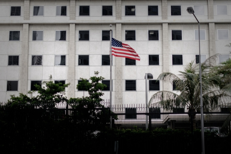 <p>The US flag flutters in front of the US consulate in Hong Kong on June 10, 2013. Edward Snowden, a 29-year-old US government contractor and the source who leaked details of a vast secret US program to monitor Internet users was reported to be in Hong Kong and remained there ever since, holed up in a hotel room.</p>