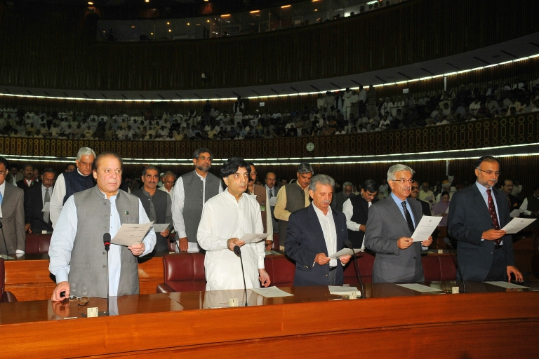 <p>Pakistani Premier-elect Nawaz Sharif (L, first row) takes the oath along with other lawmakers at Parliament House in Islamabad on June 1, 2013. Pakistan's new National Assembly was sworn in on June 1, completing the country's first-ever democratic transition of power in a country ruled for half its history by the military.</p>