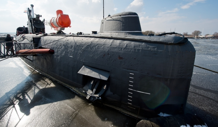 <p>A Russian submarine type JULIETT U 461 lies in the frozen water at the Maritime Museum in Peenemuende, east-northernGermany, on March 15, 2013.</p>