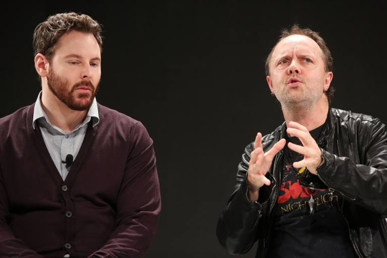 <p>Napster co-founder and former Facebook president Sean Parker (L) speaks with Metallica drummer Lars Ulrich at a Spotify event on December 6, 2012 in New York City.</p>