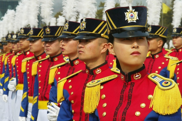 <p>South Korean cadets parade during the 60th graduation ceremony at an army military academy on March 9, 2004 in Seoul, South Korea.</p>