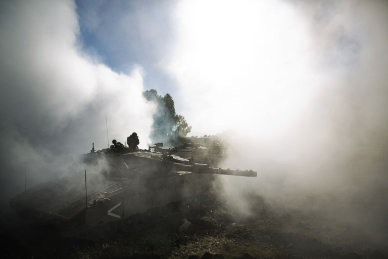 <p>An Israeli army Merkava tanks maneuvers during a drill in the Israeli annexed Golan Heights near the border with Syria on May 27, 2013. The Syrian army retook a border crossing into the Golan Heights on June 6, 2013, just hours after Syrian rebels claimed victory in capturing the UN-patrolled crossing.</p>