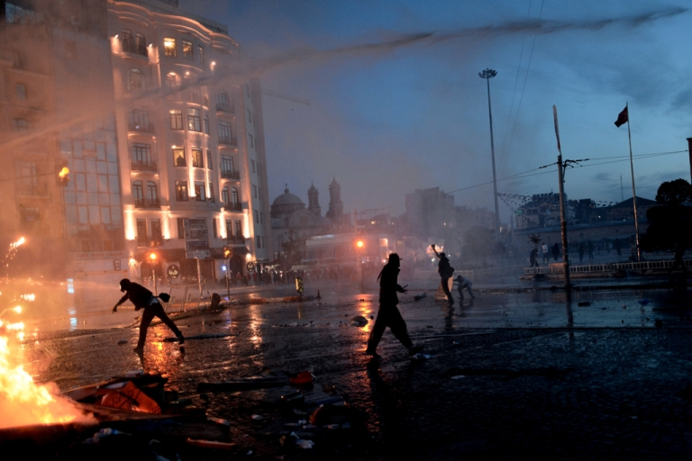 <p>Protesters clash with riot police at Taksim square in Istanbul on June 11, 2013. Riot police fired tear gas and rubber bullets to clear protesters from an Istanbul square.</p>