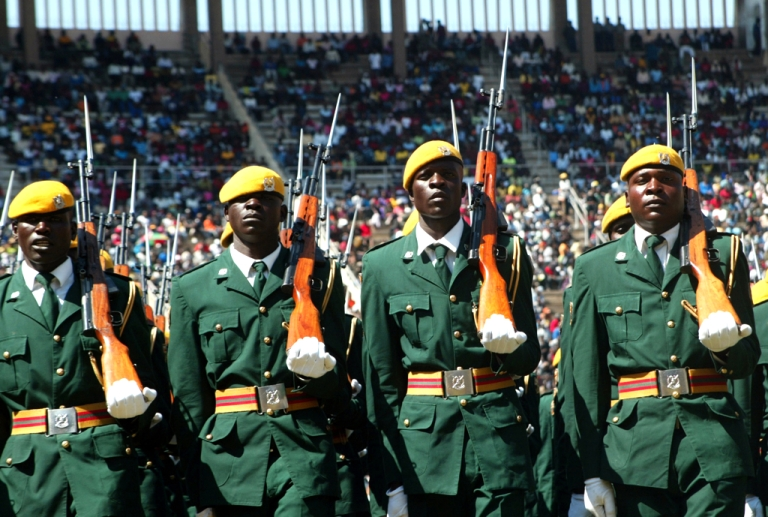 <p>Members of the Zimbabwean national army march past on a parade during defence forces day celebrations in the capital Harare in 2011.</p>