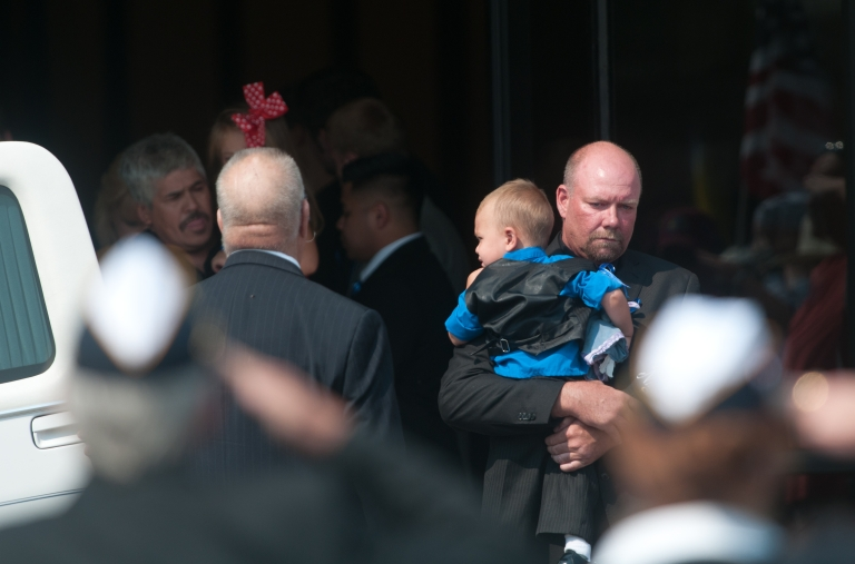 <p>Randy Blunk, father of Aurora, Colorado shooting victim Jonathan Blunk, leaves Mountain View Mortuary with his grandson Maximus following his son's service August 3, 2012 in Reno, Nevada.</p>