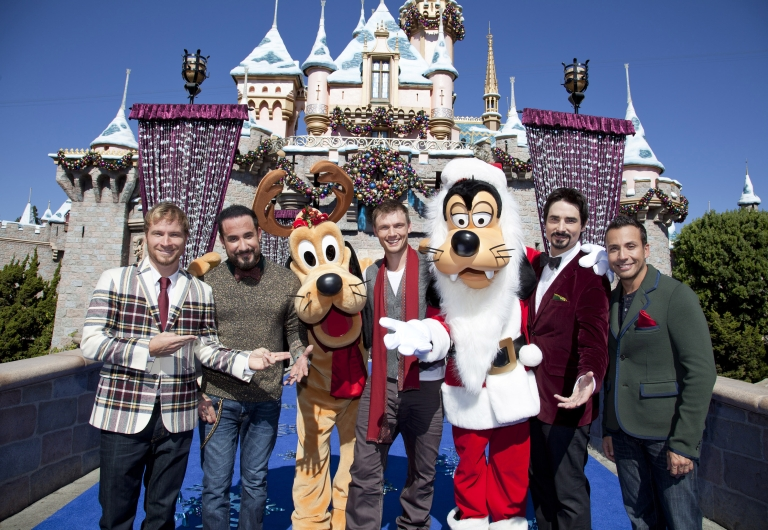 <p>Backstreet Boys pose Nov. 4, 2012 with Santa Goofy and Pluto in front of Sleeping Beauty Castle at Disneyland Park in Anaheim, California.</p>