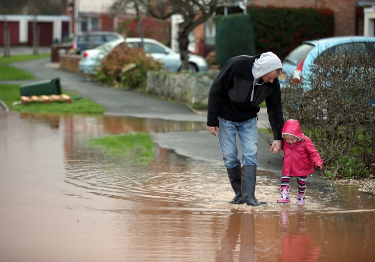 <p>A young girl splashes through flood water in Somerset, England on November 25, 2012.</p>