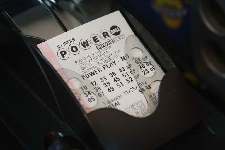 <p>A Powerball lottery ticket is printed for a customer at a 7-Eleven store on November 28, 2012 in Chicago, Illinois.</p>